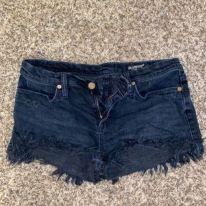 faded black denim shorts BLANKNYC